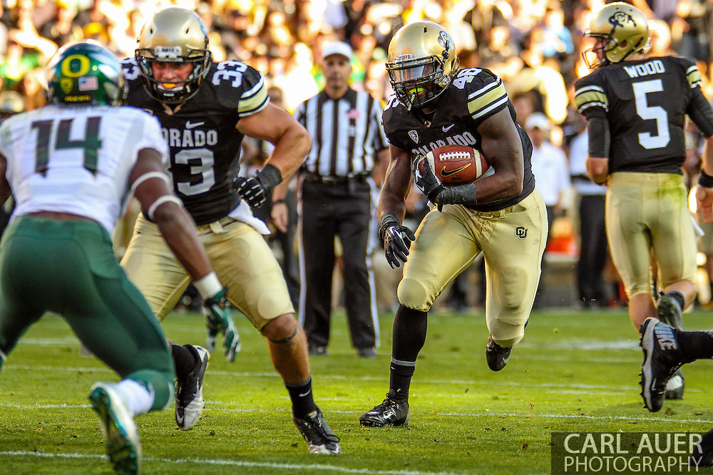 October 5th, 2013:  Colorado Buffaloes sophomore fullback Clay Jones (48) attempts to bring the ball up the middle in second quarter action of the NCAA football game between the University of Oregon Ducks and the Colorado Buffaloes at Folsom Field in Boulder, Colorado