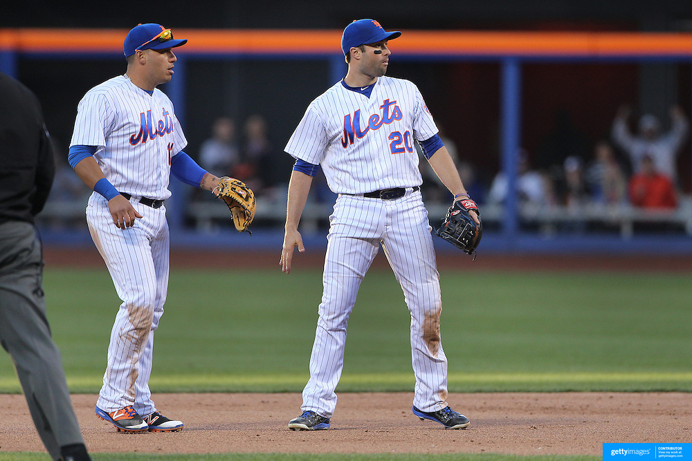 NEW YORK, NEW YORK - APRIL 30:  Shortstop Asdrubal Cabrera, (left) #13 and second baseman Neil Walker #20 of the New York Mets congratulate each other after turning a double play in the top of the ninth during the New York Mets Vs San Francisco Giants MLB regular season game at Citi Field on April 30, 2016 in New York City. (Photo by Tim Clayton/Corbis via Getty Images)