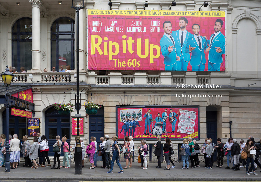 Retired theatre-goers queue outside the Garrick Theatre on Charing Cross Road to see a matinee performance of the hit musical 'Rip It Up', on 22nd May 2019, in London, England