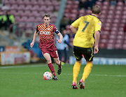 Stephen Darby (C) (Bradford) runs with the ball and sets up another attack during the The FA Cup match between Bradford City and Chesham FC at the Coral Windows Stadium, Bradford, England on 6 December 2015. Photo by Mark P Doherty.