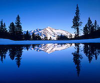 I love to take pictures near Tioga Pass in winter like my photo of a snow capped mountain reflection.   What makes this shot so cool is the mirror image of Mammoth Peak reflecting in a deep blue tarn in Yosemite National Park.