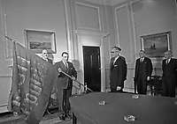 Taoiseach Seán Lemass being presented with the 'Irish Republic' flag flown over the GPO during the Easter Rising, 31 March 1966. The flag had been taken by British troops as a trophy but was later donated to the National Musuem of Ireland. Lemass himself had fought in the GPO in 1916 as a young member of the Irish Volunteers. (Part of the Independent Newspapers Ireland/NLI Collection)
