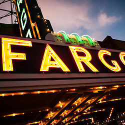 Picture of Fargo Theatre sign marquee at night in Fargo, North Dakota. The Fargo Theatre was built in 1926 and is on the National Register of Historic Places. The Fargo Theatre is currently a popular venue for films, movies, concerts, plays and other live events. Photo is vertical and was taken in 2011.