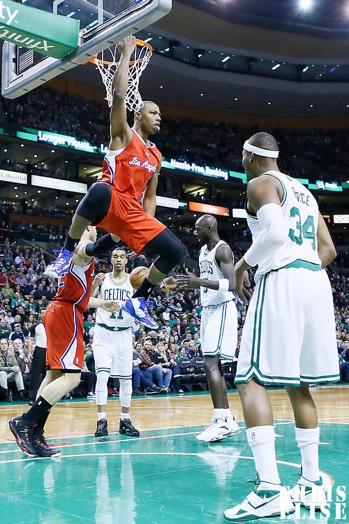 03 February 2013: Los Angeles Clippers small forward Caron Butler (5) dunks the ball over Boston Celtics power forward Kevin Garnett (5) during the Boston Celtics 106-104 victory over the Los Angeles Clippers at the TD Garden, Boston, Massachusetts, USA.