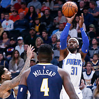 11 November 2017: Orlando Magic guard Terrence Ross (31) takes a jump shot over Denver Nuggets forward Wilson Chandler (21) and Denver Nuggets forward Paul Millsap (4) during the Denver Nuggets 125-107 victory over the Orlando Magic, at the Pepsi Center, Denver, Colorado, USA.
