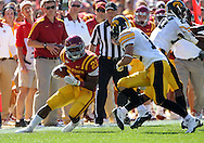September 10, 2011: Iowa State Cyclones running back Shontrelle Johnson (21) tries to cut back on a run during the first half of the game between the Iowa Hawkeyes and the Iowa State Cyclones during the Iowa Corn Growers Cy-Hawk game at Jack Trice Stadium in Ames, Iowa on Saturday, September 10, 2011. Iowa State defeated Iowa 44-41 in 3OT.