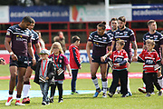 Leeds Rhinos centre Kallum Watkins (3) leads the Leeds Rhinos out holding the hands of young mascots during the Betfred Super League match between Hull Kingston Rovers and Leeds Rhinos at the Lightstream Stadium, Hull, United Kingdom on 29 April 2018. Picture by Mick Atkins.