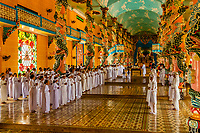 MIdday mass at Cao Dai Great Temple in Tay Ninh, north of Ho Chi Minh City (Saigon), Vietnam. Caodaism is a monotheistic religion which mixes Taoism, Buddhism, and Confucianism.