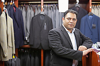 Portrait of businessman standing in menswear store