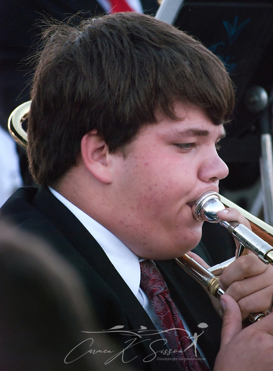 Dalton Steiner plays the trombone with the Alba Middle School Jazz Band during the annual Christmas tree lighting ceremony  Dec. 4, 2010 in Bayou La Batre, Ala. Members of the ALBA Club and the Bayou La Batre City Council participated in the evening's festivities. (Photo by Carmen K. Sisson/Cloudybright)