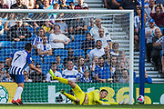 Nick Pope (GK) (Burnley) saves the ball during the Premier League match between Brighton and Hove Albion and Burnley at the American Express Community Stadium, Brighton and Hove, England on 14 September 2019.
