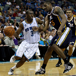 April 11, 2011; New Orleans, LA, USA; New Orleans Hornets point guard Chris Paul (3) drives past Utah Jazz power forward Derrick Favors (15) during the second half at the New Orleans Arena. The Jazz defeated the Hornets 90-78.  Mandatory Credit: Derick E. Hingle