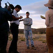 Civil Homeland Defense founder and Minuteman Project organizer Chris Simcox talks to reporters near the US/Mexico border fence near Naco, Arizona on Saturday, April 2, 2005. The Minuteman Project is an all-volunteer group monitoring the US/Mexico border in Arizona for the month of April, reporting all illegal border crossers to the US Border Patrol.<br />