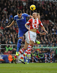 Chelsea's John Terry battles for the high ball with Stoke City's Peter Crouch and Stoke City's Stephen Ireland - Photo mandatory by-line: Joe Meredith/JMP - Tel: Mobile: 07966 386802 07/12/2013 - SPORT - Football - Stoke-On-Trent - Britannia Stadium - Stoke City v Chelsea - Barclays Premier League