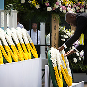 NAGASAKI, JAPAN - AUGUST 9 : Members of foreign delegation lays wreath for the atomic bomb victims in front of the Peace Statue in Nagasaki Peace Park, Nagasaki, southern Japan, Tuesday, August 9, 2016. Japan marked the 71st anniversary of the atomic bombing on Nagasaki. On August 9, 1945, during World War II, the United States dropped the second Atomic bomb on Nagasaki city, killing an estimated 40,000 people which ended World War II. (Photo by Richard Atrero de Guzman/NURPhoto)