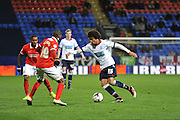 Bolton Wanderers defender, Derik Osede (15) takes on Charlton Athletic defender Zakarya Bergdich (19) during the Sky Bet Championship match between Bolton Wanderers and Charlton Athletic at the Macron Stadium, Bolton, England on 19 April 2016. Photo by John Marfleet.