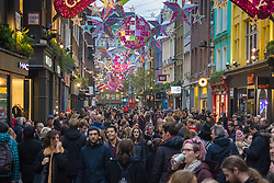 London, December 12th 2015. Tens of thousands of shoppers descend on London's west end as retailers keep prices low to encourage volume sales in the run-up to Christmas. PICTURED:  Carnaby Street. ///FOR LICENCING CONTACT: paul@pauldaveycreative.co.uk TEL:+44 (0) 7966 016 296 or +44 (0) 20 8969 6875. ©2015 Paul R Davey. All rights reserved.