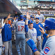NEW YORK, NEW YORK - June 30: Kris Bryant #17 of the Chicago Cubs is congratulated by team mates as he returns to the dugout with Ben Zobrist #18 of the Chicago Cubs after hitting a two run home run in the first inning during the Chicago Cubs Vs New York Mets regular season MLB game at Citi Field on June 30, 2016 in New York City. (Photo by Tim Clayton/Corbis via Getty Images)