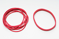 Red rubber bands on white background