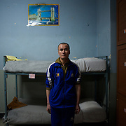 November 14, 2012 - Kabul, Afghanistan: A Afghan National Police (ANP) cadet stands beside is bed at a dorm in the Afghan Nacional Police Academy...ANP Academy trains 1250 cadets at the time during a period of four years. Every year, five hundred new recruits are selected, out of more than nine thousand of candidates, to join the academy and other five hundred graduate. Fifteen per cent of the recruits are women. (Paulo Nunes dos Santos)