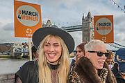 Natasha Bedingfield and Annie Lennox share a joke- Thousands join CARE International's #March4Women campaign in London celebrating International Women's Day.
