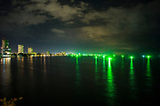 13 May 2017. Hua Hin, Thailand.<br /> Fishing boats looking for squid sit off the coast of Hua Hin Thailand. The fisherman use florescent green lights to help attract the squid to their boats.<br /> Photographer: Rick Findler