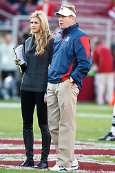 November 6, 2010; Stanford, CA, USA;  Arizona Wildcats head coach Mike Stoops (right) talks with ESPN commentator Erin Andrews before the game against the Stanford Cardinal at Stanford Stadium. Stanford defeated Arizona 42-17.