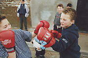 Two kids boxing on Winterbourne Travellers site, Bristol, UK, 1990's
