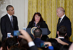 October 12, 2016 - Washington, District of Columbia, United States of America - Roxane Giron flanked by  United States President Barack Obama (L) and Vice President Joe Biden  speaks at a reception for Hispanic Heritage Month in the East Room of the White House on October 12, 2016 in Washington, DC. .Credit: Olivier Douliery / Pool via CNP (Credit Image: © Olivier Douliery/CNP via ZUMA Wire)