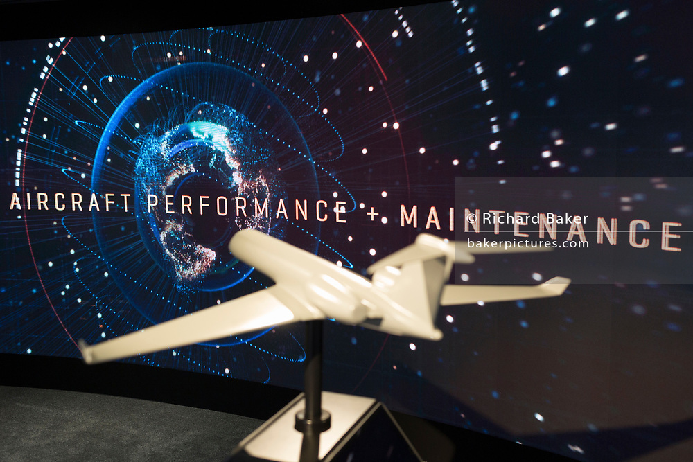 A model of a generic aircraft and the images from a video presentation in the exhibition chalet of United Technologies, at the Farnborough Airshow, on 16th July 2018, in Farnborough, England. United Technologies are the parent company to  Otis, UTC Climate, Controls & Security and Pratt & Whitney. (Photo by Richard Baker / In Pictures via Getty Images)