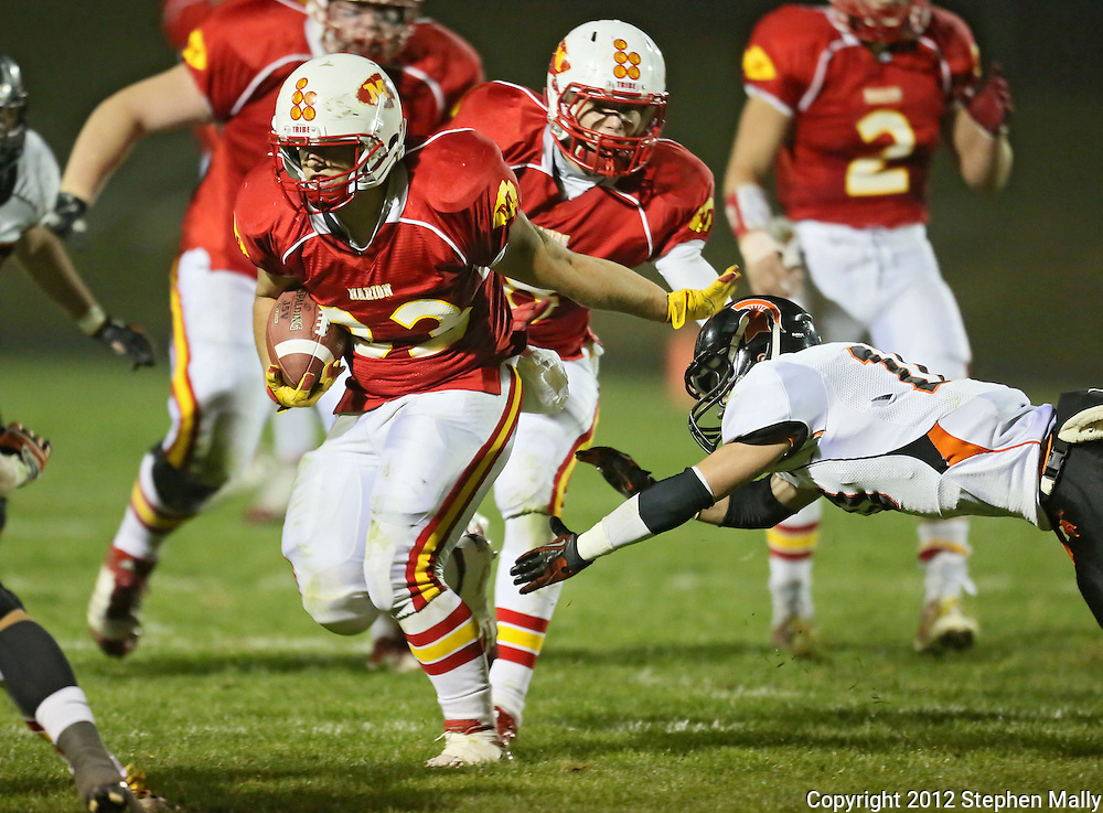 Marion's Trev Biery (33) holds off Solon's Colton Dall (10) on a run during the first half of the game between the Solon Spartans and the Marion Indians at Thomas Park Field in Marion on Friday evening, October 5, 2012.