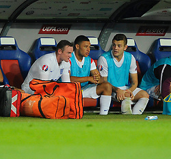 England captain, Wayne Rooney (Manchester United) on the bench with England's Jack Wilshere (Arsenal) and England's Alex Oxlade-Chamberlain (Arsenal) - Photo mandatory by-line: Joe Meredith/JMP - Mobile: 07966 386802 - 08/09/14 - SPORT - FOOTBALL - Switzerland - Basel - St Jacob Park - Switzerland v England - Uefa Euro 2016 Group E Qualifier