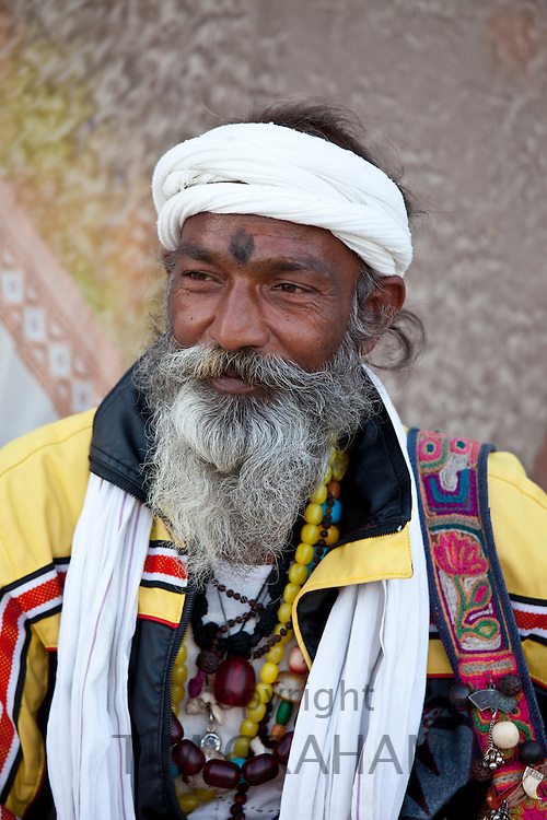 Hindu man pilgrim with beads and turban at Dashashwamedh Ghat in holy city of Varanasi, Benares, India
