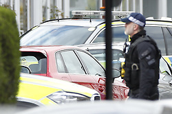 © Licensed to London News Pictures. 19/03/2019. London, UK. Armed police surround a red car where a man is holding a gun near Lower Addiscombe Road in south London <br />