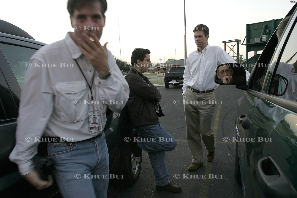 Members of the press gather at the Baylor University softball fields for an escort to Air Force One Wednesday, November 26, 2003, in Waco, TX.  President Bush made an unscheduled trip to Baghdad, Iraq.  (L-R) Time Magazine photographer Chris Usher, Associated Press photographer Pablo Martinez Monsivais, Bloomberg White House correspondent Dick Keil, and Reuters photographer Larry Downing (in mirror)...Photo by Khue Bui