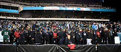 Members of the Imhotep Panthers football team watch the Eagles game standing on field bleachers. <br /> <br /> Football players of PIAA AAA State champions Imhotep Panthers and Pop Warner Midget Div. I National Champions NW Raiders got invited to see the December 26, 2015 NFC East Division game between Washington Redskins and Philadelphia Eagles at Lincoln Financial. 9photo by Bastiaan Slabbers)