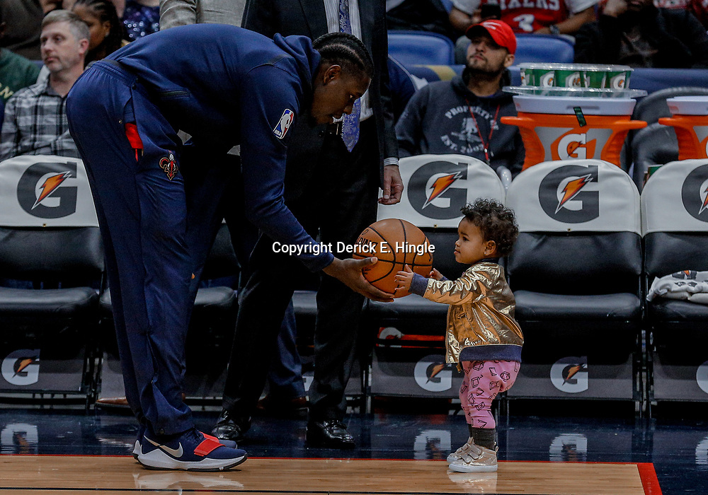 Dec 10, 2017; New Orleans, LA, USA; New Orleans Pelicans guard Jrue Holiday (11) with his daughter Jrue Tyler Holiday before a game against the Philadelphia 76ers at the Smoothie King Center. Mandatory Credit: Derick E. Hingle-USA TODAY Sports
