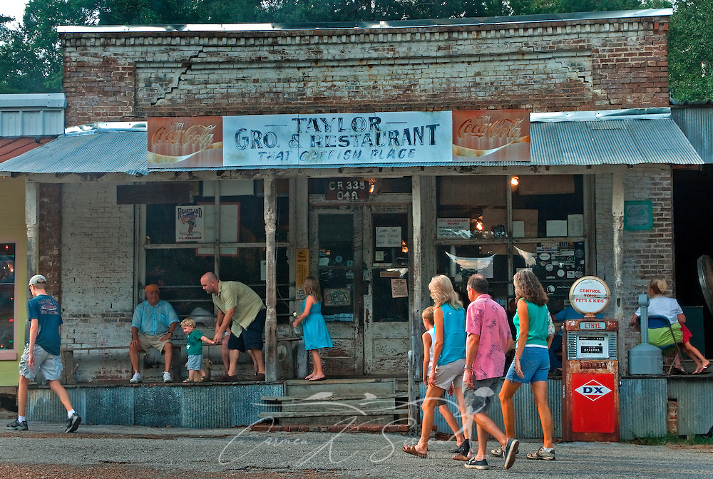 Customers wait for a table at Taylor Grocery, July 31, 2011, in Taylor, Mississippi. Taylor Grocery was founded more than a century ago, and the restaurant — famous for its fried catfish — opened in 1977. (Photo by Carmen K. Sisson/Cloudybright)