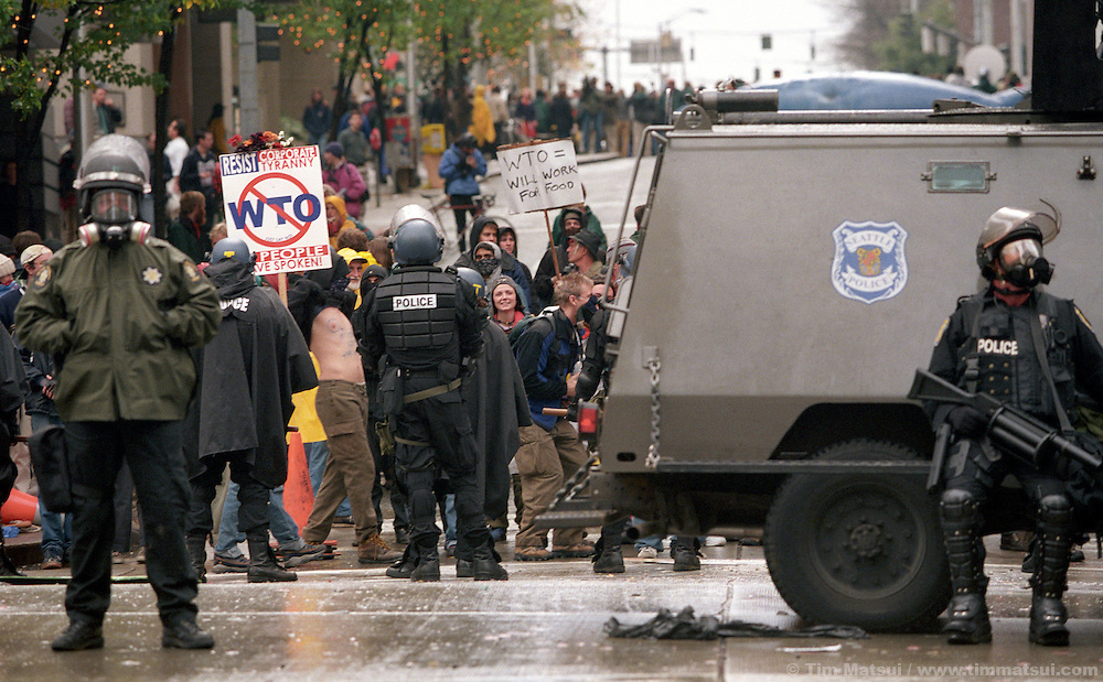 """During the World Trade Organization meeting in Seattle in 1999, tens of thousands gathered to protest, effectively shutting down the WTO talks as delegates were unable to get to the convention center. Peaceful protests devolved into a riot now known as """"the Battle in Seattle"""" as Seattle Police employed batons, tear gas, pepper spray, non-lethal projectiles and concussion grenades to hold protesters at bay. Support from neighboring agencies was called and the National Guard was deployed as Mayor Paul Schell declared a civil emergency, downtown no-protest zone, and curfew."""