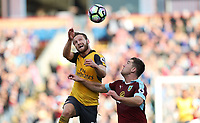 Football - 2016 / 2017 Premier League - Burnley v Arsenal at Turf Moor<br /> <br /> Shkodran Mustafa of Arsenal and Sam Vokes of Burnley challenge for the ball.<br /> <br /> COLORSPORT/LYNNE CAMERON