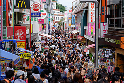 Very crowded pedestrian shopping  Takeshita Street on trendy Harajuku district of Tokyo Japan