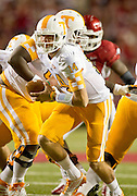 Nov 12, 2011; Fayetteville, AR, USA; Tennessee Volunteers quarterback Justin Worley (14) looks to hand off the ball during the first half of a game against the Arkansas Razorbacks at Donald W. Reynolds Razorback Stadium. Arkansas defeated Tennessee 49-7. Mandatory Credit: Beth Hall-US PRESSWIRE