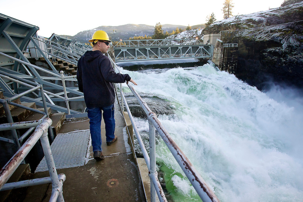 LaRoy Dowd, Post Falls dam manager for Avista, walks above the spillway Wednesday where an estimated 12,000 cubic feet of water per second is flowing in order to reduce the water level of Lake Coeur d'Alene which was two feet above the summer elevation.