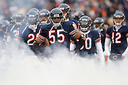 Lance Briggs (55) and the Chicago Bears look on before the start of the NFC Divisional Playoff game against the Seattle Seahawks on Jan. 16, 2011 at Soldier Field in Chicago, Illinois. The Bears won 35-24. (Photo by Joe Robbins)