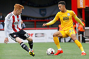 Preston North End forward Callum Robinson (37) looks to take on Brentford midfielder Ryan Woods (15) during the EFL Sky Bet Championship match between Brentford and Preston North End at Griffin Park, London, England on 17 September 2016. Photo by Andy Walter.