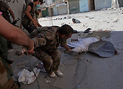 Free Syrian Army soldiers evacuate the body of a dead Imam from Salahddine Street in Aleppo August 13,2012 . (Photo by Heidi Levine/Sipa Press).