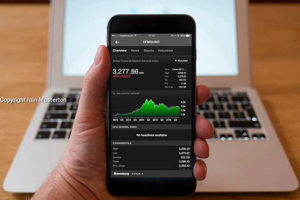 Using iPhone smartphone to display stock market performance chart for Dubai Financial Market General index