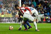 Real Madrid's player James Rodriguez and Sporting de Gijon's player Douglas during match of La Liga between Real Madrid and Sporting de Gijon at Santiago Bernabeu Stadium in Madrid, Spain. November 26, 2016. (ALTERPHOTOS/BorjaB.Hojas)