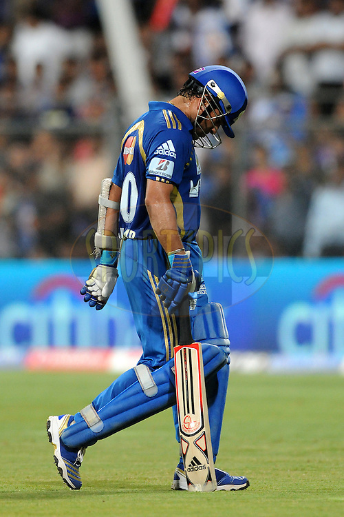 Sachin Tendulkar captain of Mumbai Indians walks back after getting out during match 66 of the Indian Premier League ( IPL ) Season 4 between the Mumbai Indians and the Rajasthan Royals held at the Wankhede Stadium, Mumbai, India on the 20th May 2011..Photo by PalPillai/BCCI/SPORTZPICS.