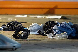 © Licensed to London News Pictures. 20/08/2018. London, UK. Personal belongings including shoes, a baseball cap and jeans lie on the floor at the scene of a shooting on Kingsbury Road in North London in which three people have been shot. No arrests have been made after emergency services rushed to the scene on Kingsbury High Road in Brent at 9.45pm. Photo credit: Ben Cawthra/LNP